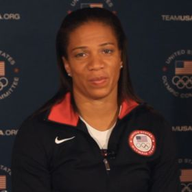 EXCLUSIVE: U.S. Paralympic Runner April Holmes On Sharing Gold With Fellow Americans