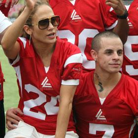 Jennifer Lopez And Casper Smart Cuddle At Charity Football Game
