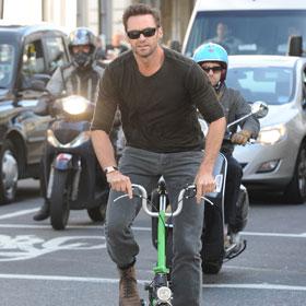 Hugh Jackman Bikes Around London