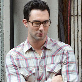 Adam Levine Gives A Clark Kent Stare On 'Can A Song Save Your Life?' Set