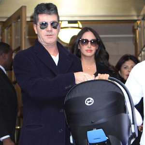 Simon Cowell & Lauren Silverman Bring Son Home From Hospital